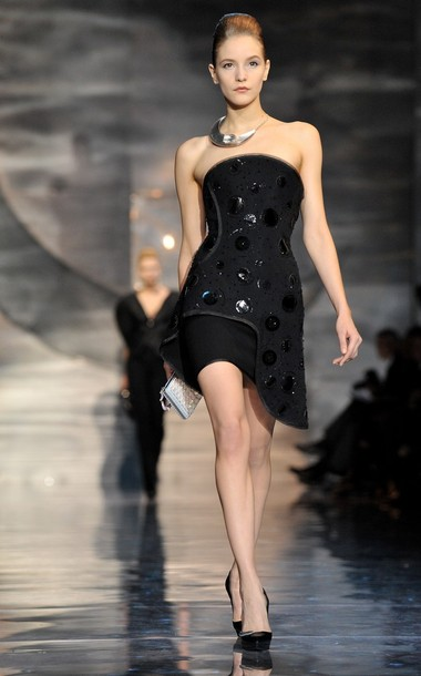 PARIS - JANUARY 25: A model walks down the catwalk for the Giorgio Armani Prive Fashion Show during Paris Fashion Week Haute Couture S/S 2010 at Palais de Chaillot on January 25, 2010 in Paris, France. (Photo by Pascal Le Segretain/Getty Images)